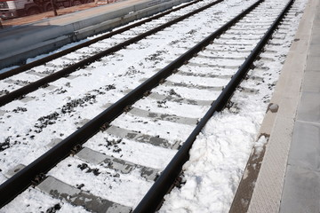 tracks in the snow-covered station