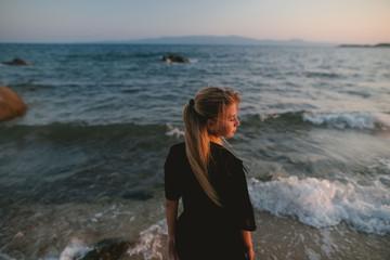 Free happy woman enjoying sunset, girl in sportswear,bikini,swimwear