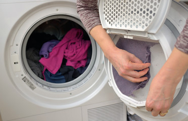 Woman Taking the lent of Dryer