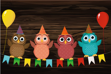 Four lovely colored owls, sitting on a garland with flags holding
