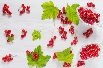 Red currant fruits on a wooden background