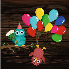 Cute owl sitting on a branch and holding many colorful balloons.