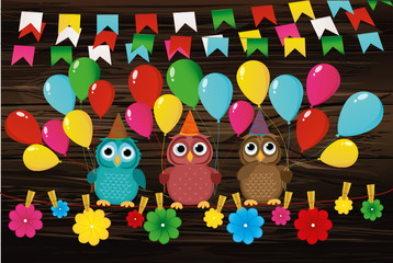 Three lovely owls sit on a rope and hold balloons. Hanging