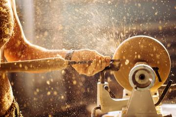 Wood lathe .The naked Carpenter lathing wood to make product