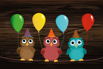 Three cute colored owls sitting on a rope and holding balloons.