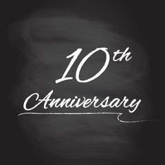 10th anniversary emblem hand drawn by chalk. 10 years celebration isolated on blackboard background. Vector illustration.