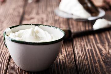 Homemade cream cheese frosting in rural mug