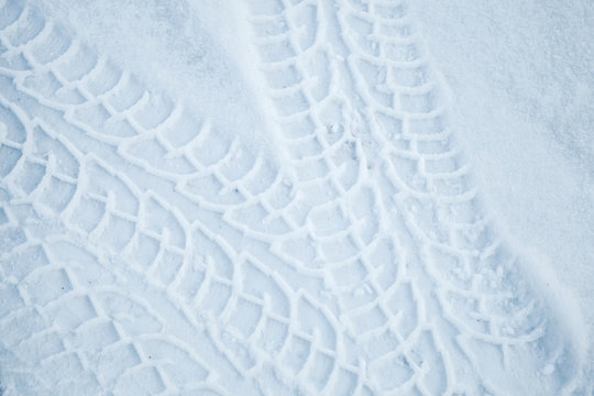 Tire tracks pattern on winter road with snow