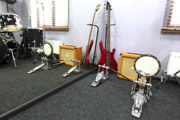 musical instruments in the studio with a mirror
