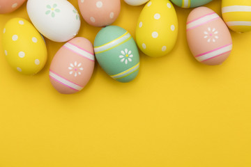 Painted easter eggs on a bright yellow background