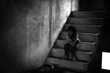 Depressed young girl sitting alone in an abandoned building Wall mural