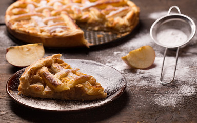 Apple  Pie on wooden table surface