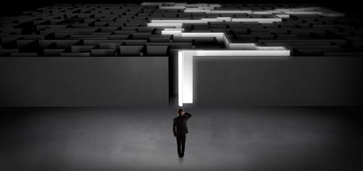 Wall Mural - Businessman starting a stated dark labyrinth