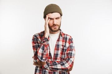 Portrait of a puzzled bearded man in plaid shirt
