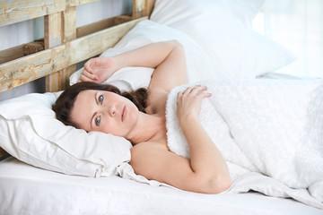 Young girl. White bed. Awakening