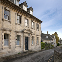 Winter sunshine on the picturesque old Cotswold village streets of Painswick, Gloucestershire, UK