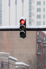 Traffic light outside under a heavy snow