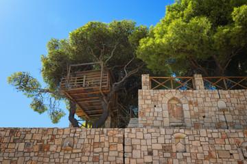 Tree house near Kampi, Greece. Summer sunny day.