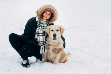 Picture of smiling girl with labrador in winter park