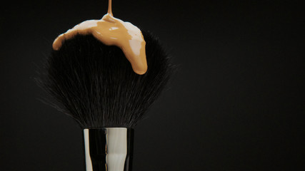 black brush with a liquid foundation pouring on it