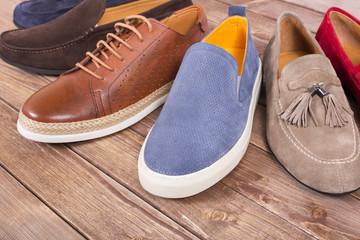 men's shoes on wooden floor