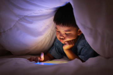 Kid using tablet play learning application games.