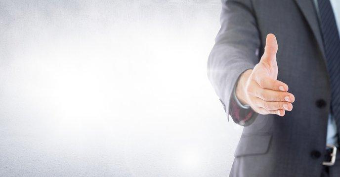 Handshake reach of businessman