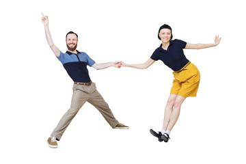 Lindy hop or rock'n'roll dance boogie woogie. Boogie acrobatic stunt in a studio background. Dance for rock-n-roll music.