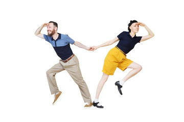 Dancers are looking for something. Boogie or lindy hop in a studio background. Dance for rock-n-roll music.