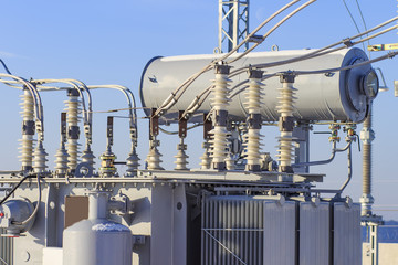 Powerful electrical transformer at high-voltage substation. Industrial electrical equipment.