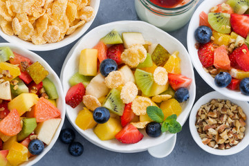 healthy breakfast with fresh fruit salad, top view, closeup