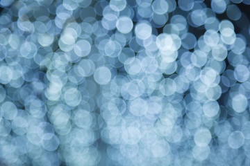 Abstract dreamy delicate soft tender defocused white light illumination Bokeh. Good for Background, backdrop, pattern, screensaver, design, wallpaper or presentation template.