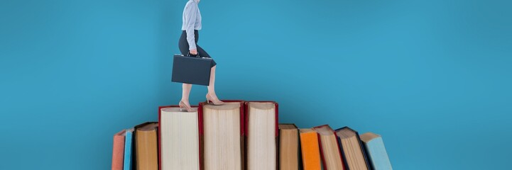 Business woman climbing books with blue background