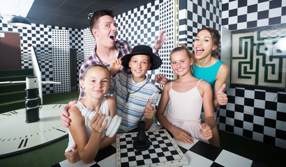 Family with kids are satisfied after visit of escape room
