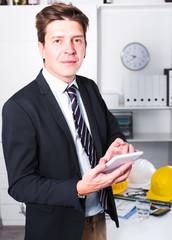Man using tablet at office