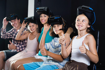 Family of five is satisfied of VR together in the room.