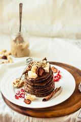 Chocolate pancakes with banana, peanut butter, cinnamon and maple syrup. Place for text