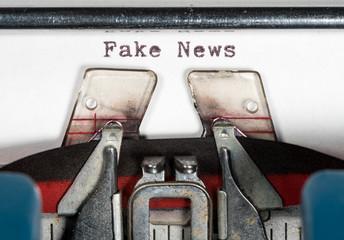 Macro detail of Fake News on electric typewriter with ribbon
