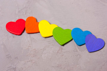 Wooden hearts of the color of the rainbow . symbol of LGBT