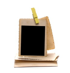 Old photo frame with wooden clothespin isolated on white background