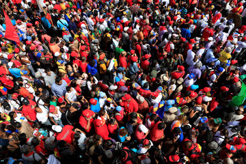 Supporters of Venezuela's President Nicolas Maduro attend a rally with him outside the National Electoral Council (CNE) headquarters after he registered his candidacy for re-election, in Caracas