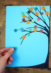 tree of colored buttons on a blue background