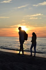 couple at the beach during sunset
