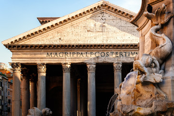 Fountain and the ancient roman Pantheon in Rome at sunset