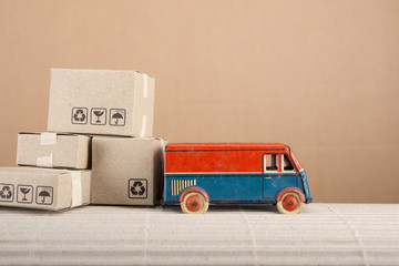 Vintage toy truck with cardboard boxes. Shipping and delivery concept.