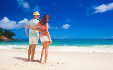 attractive couple enjoying sunny day at Maia Beach. Mahe, Seychelles