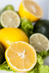 Juicy lemons and lime, green lettuce and avocado