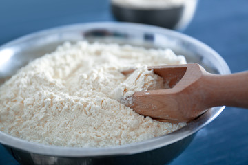 Bowl with flour and scoop, closeup