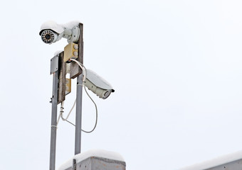 The system of video surveillance on a fence in  winter