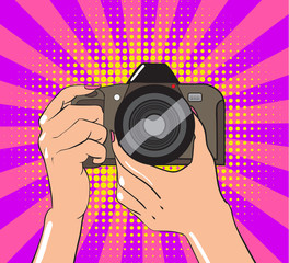 Human hands with photo camera in comic book style. Vector illustration.
